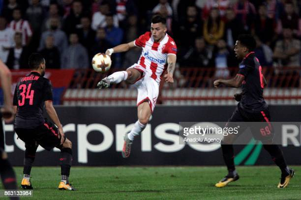 Francis Coquelin and Joseph Willock of Arsenal in action during the UEFA Europa League Group H soccer match between Crvena Zvezda and Arsenal at...