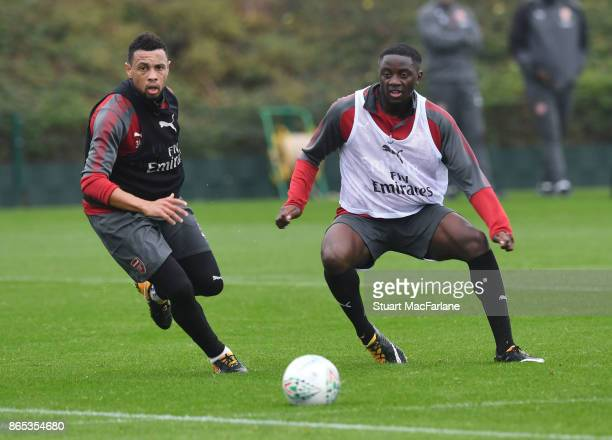 Francis Coquelin and Josh Dasilva of Arsenal during a training session at London Colney on October 23 2017 in St Albans England