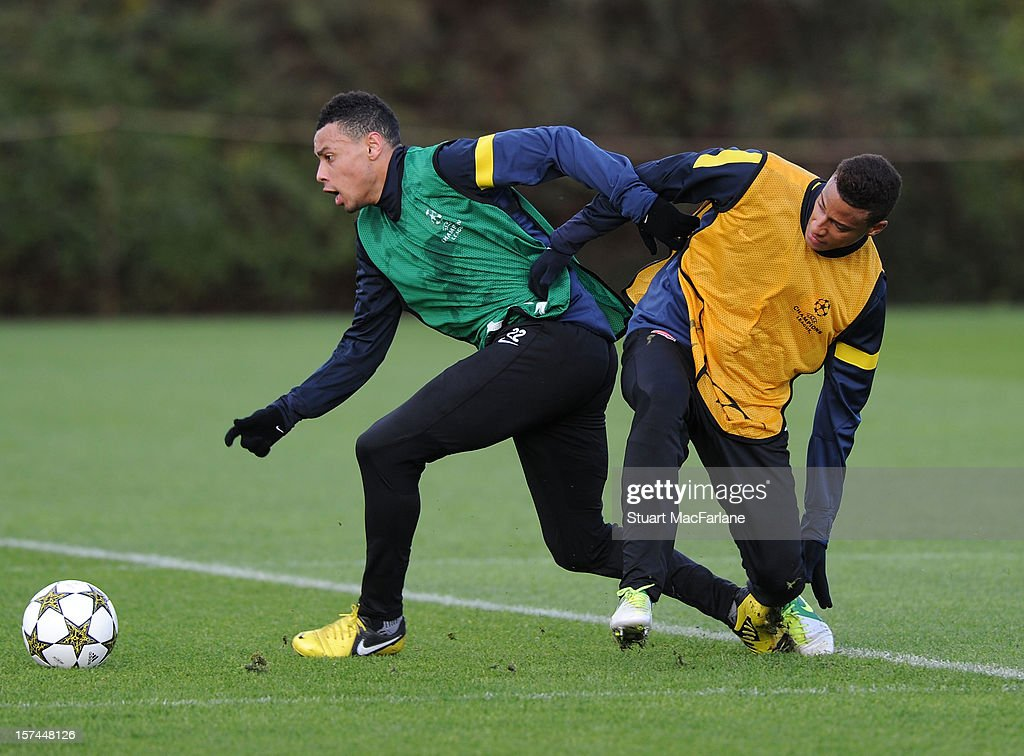 Francis Coquelin and Martin Angah of Arsenal during a training session at London Colney on December 03, 2012 in St Albans, England.