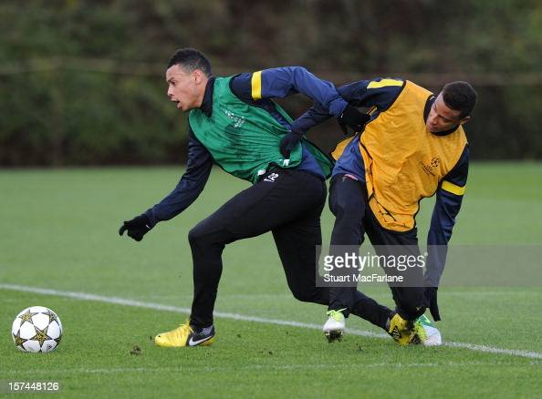 Francis Coquelin and Martin Angah of Arsenal during a training session at London Colney on December 03 2012 in St Albans England