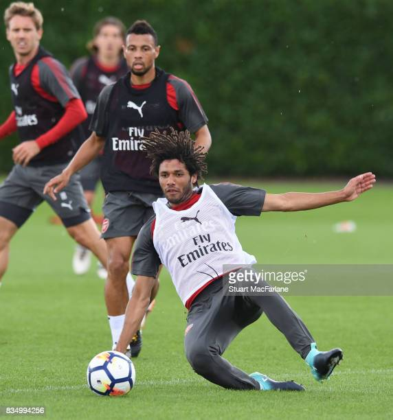 Francis Coquelin and Mohamed Elneny of Arsenal during a training session at London Colney on August 18 2017 in St Albans England