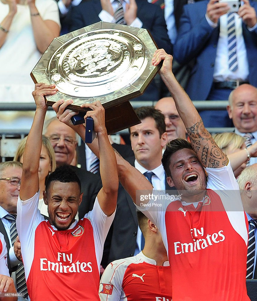 Francis Coquelin and Olivier Giroud of Arsenal lift the Community Shield after the FA Community Shield match between Chelsea and Arsenal at Wembley Stadium on August 2, 2015 in London, England.