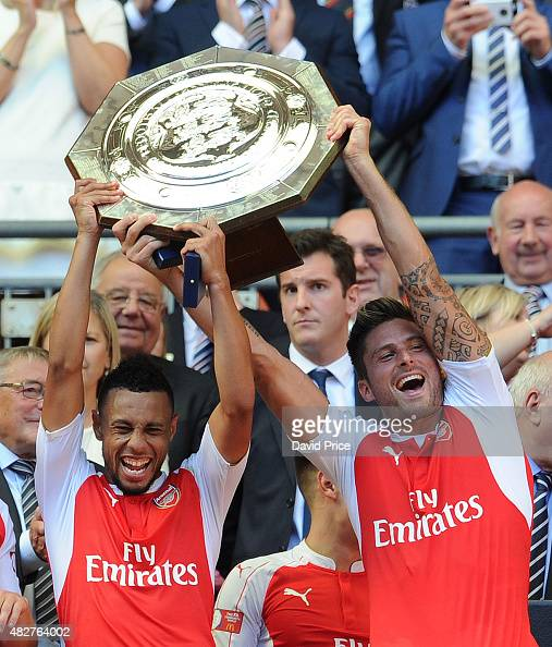 Francis Coquelin and Olivier Giroud of Arsenal lift the Community Shield after the FA Community Shield match between Chelsea and Arsenal at Wembley...