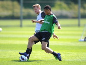Francis Coquelin and Per Mertesacker of Arsenal during a training session at London Colney on May 03 2013 in St Albans England