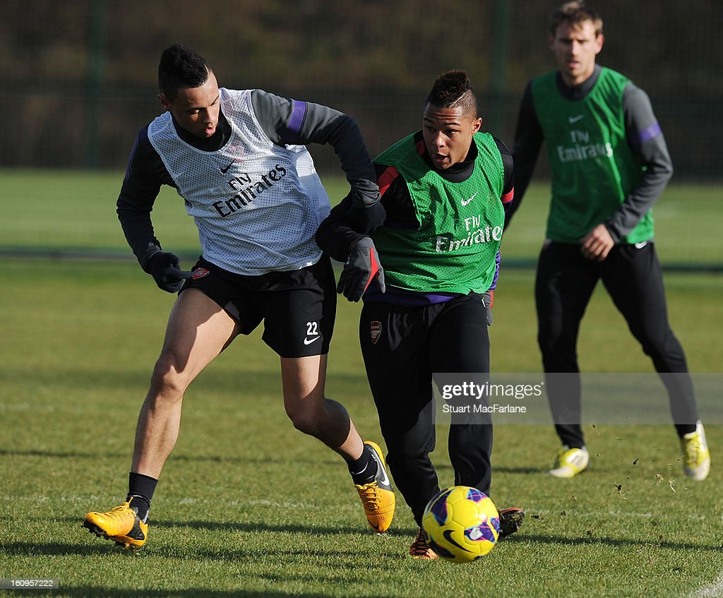 Francis Coquelin and Serge Gnabry of Arsenal during a training session at London Colney on February 08, 2013 in St Albans, England.