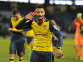 Francis Coquelin celebrates the Arsenal victory after the Barclays Premier League match between Manchester City and Arsenal at Etihad Stadium on...