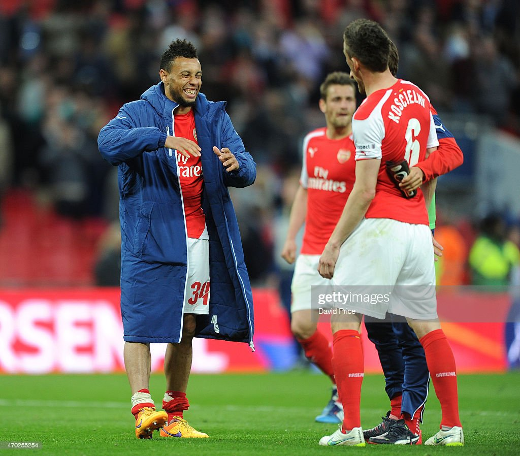 Francis Coquelin celebrates with Laurent Koscielny of Arsenal after the match between Arsenal and Reading in the FA Cup Semi Final at Wembley Stadium on April 18, 2015 in London, England.