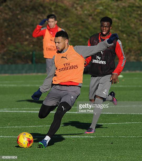 Francis Coquelin is closed down by Stephy Mavididi of Arsenal during Arsenal Training Session at London Colney on November 29 2016 in St Albans...