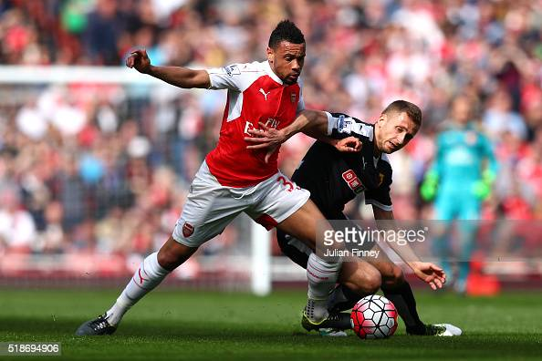 Francis Coquelin of Arsenal and Almen Abdi of Watford compete for the ball during the Barclays Premier League match between Arsenal and Watford at...