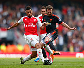 Francis Coquelin of Arsenal and Juan Mata of Manchester United during the Barclays Premier League match between Arsenal and Manchester United at...