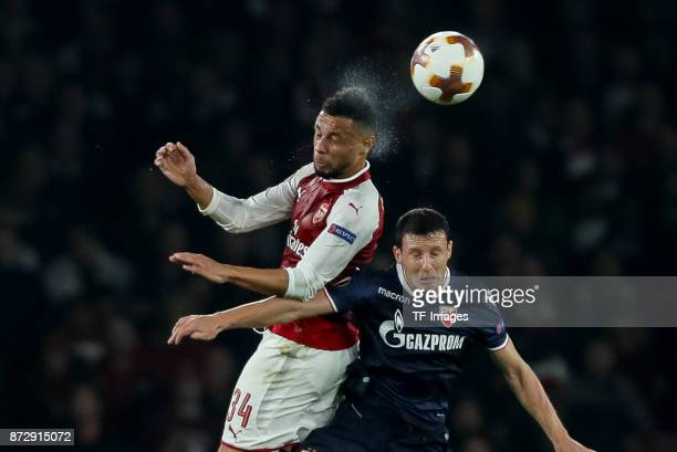 Francis Coquelin of Arsenal and Slavoljub Srnic of Red Star Belgrade battle for the ball during UEFA Europa League Group H match between Arsenal and...