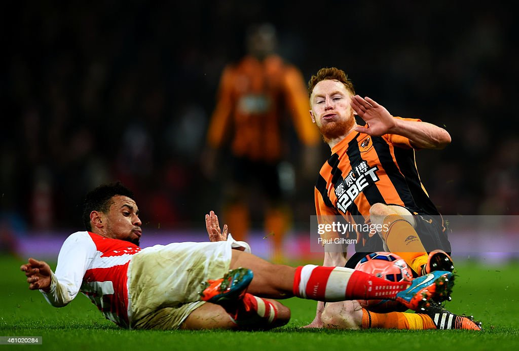 Francis Coquelin of Arsenal battles for the ball with Stephen Quinn of Hull City during the FA Cup Third Round match between Arsenal and Hull City at...