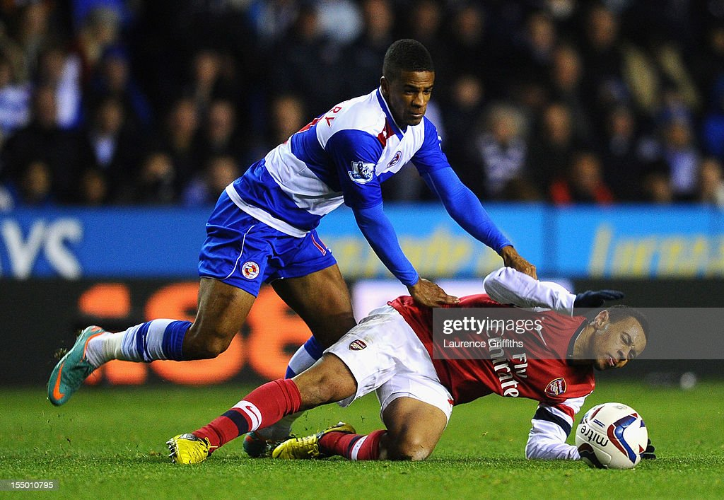 Francis Coquelin of Arsenal battles with Gareth McCleary of Reading during the Capital One Cup Fourth Round match between Reading and Arsenal at Madejski Stadium on October 30, 2012 in Reading, England.