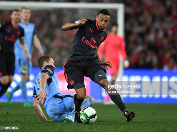 Francis Coquelin of Arsenal breaks past Brandon O'Neill of Sydney FC during the preseason friendly match between Sydney FC and Arsenal at ANZ Stadium...