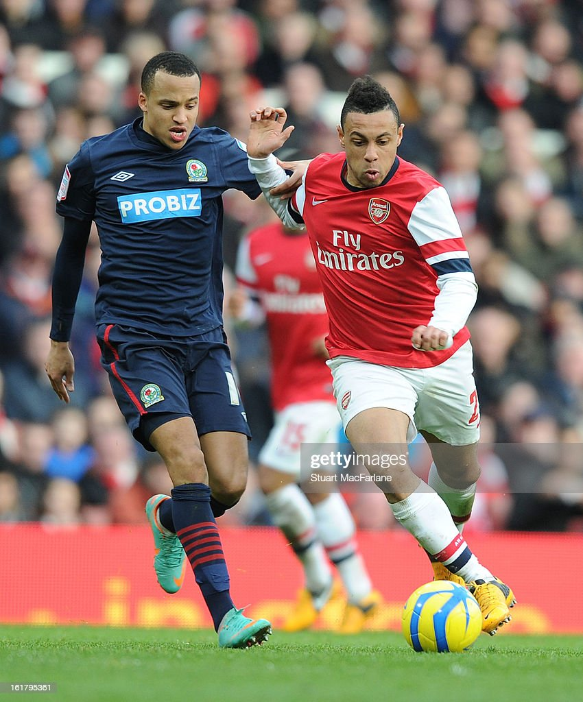 Francis Coquelin of Arsenal breaks past Markus Olsson of Blackburn during the FA Cup Fifth Round match between Arsenal and Blackburn Rovers at the Emirates Stadium on February 16, 2013 in London, England.