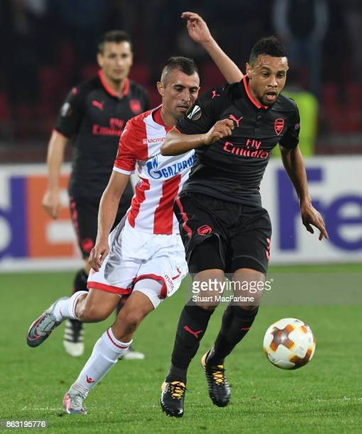 Francis Coquelin of Arsenal breaks past Nenad Krsticic of Red Star during the UEFA Europa League group H match between Crvena Zvezda and Arsenal FC...