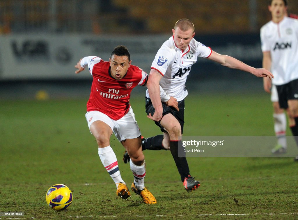 Francis Coquelin of Arsenal bursts past Larnell Cole of Man Utd during the Barclays Premier U21 match between Arsenal U21 and Manchester United U21 at Underhill Stadium on March 20, 2013 in Barnet, United Kingdom.