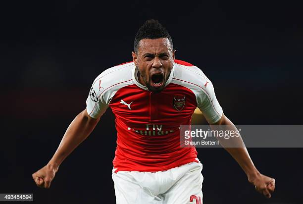 Francis Coquelin of Arsenal celebrates as Olivier Giroud scores their first goal during the UEFA Champions League Group F match between Arsenal FC...
