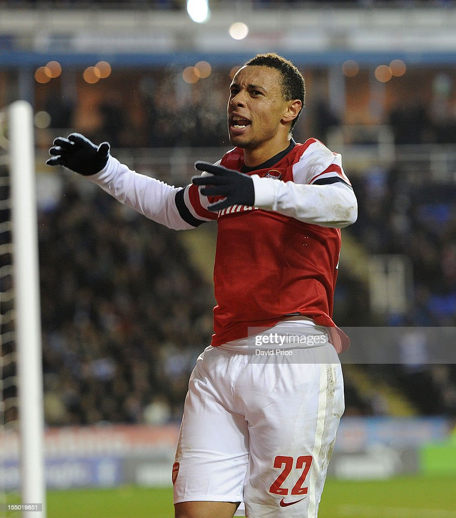 Francis Coquelin of Arsenal celebrates at the end of the 90 minutes during the Capital One Cup match between Arsenal and Reading at Madejski Stadium on October 30, 2012 in Reading, England.