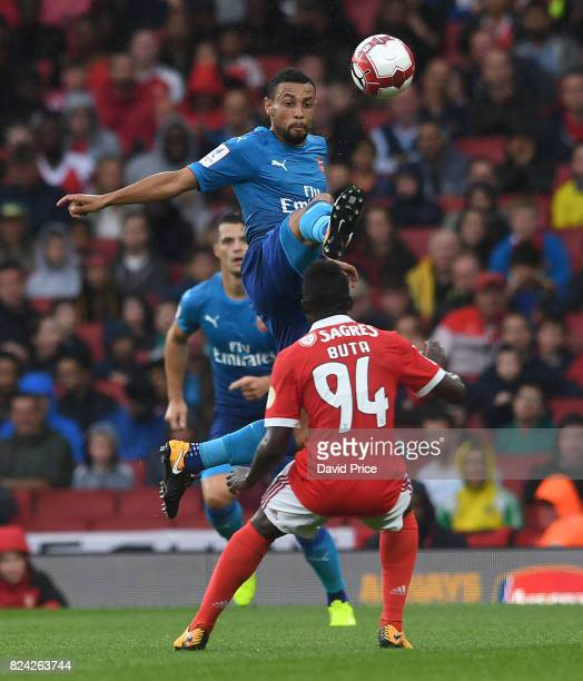 Francis Coquelin of Arsenal challenges Buta of Benfica during the match between Arsenal and SL Benfica at Emirates Stadium on July 29 2017 in London...