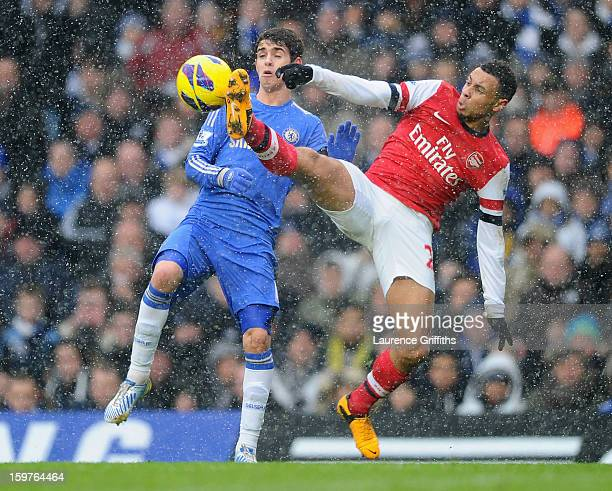Francis Coquelin of Arsenal challenges Oscar of Chelsea during the Barclays Premier League match between Chelsea and Arsenal at Stamford Bridge on...