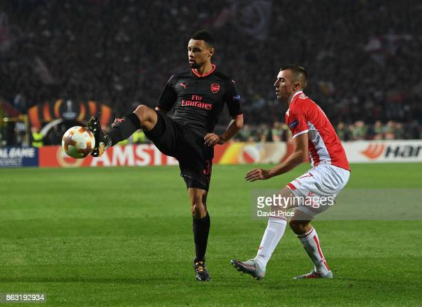 Francis Coquelin of Arsenal controls the ball under pressure from Nenad Krsticic of Red Star during the UEFA Europa League group H match between...