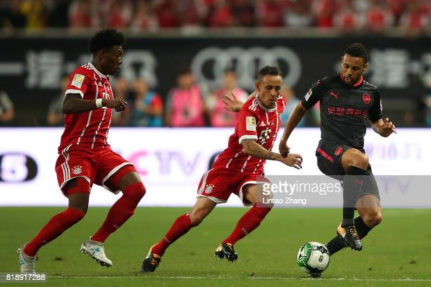 Francis Coquelin of Arsenal FC of Arsenal FC competes for the ball with Rafinha of FC Bayern during the 2017 International Champions Cup football...
