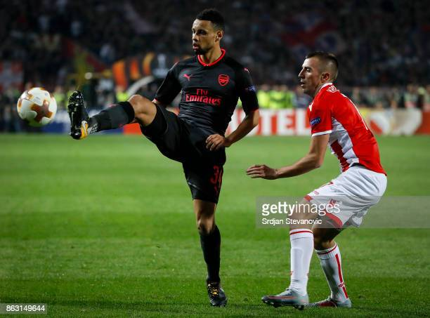 Francis Coquelin of Arsenal in action against Nenad Krsticic of Crvena Zvezda during the UEFA Europa League group H match between Crvena Zvezda and...