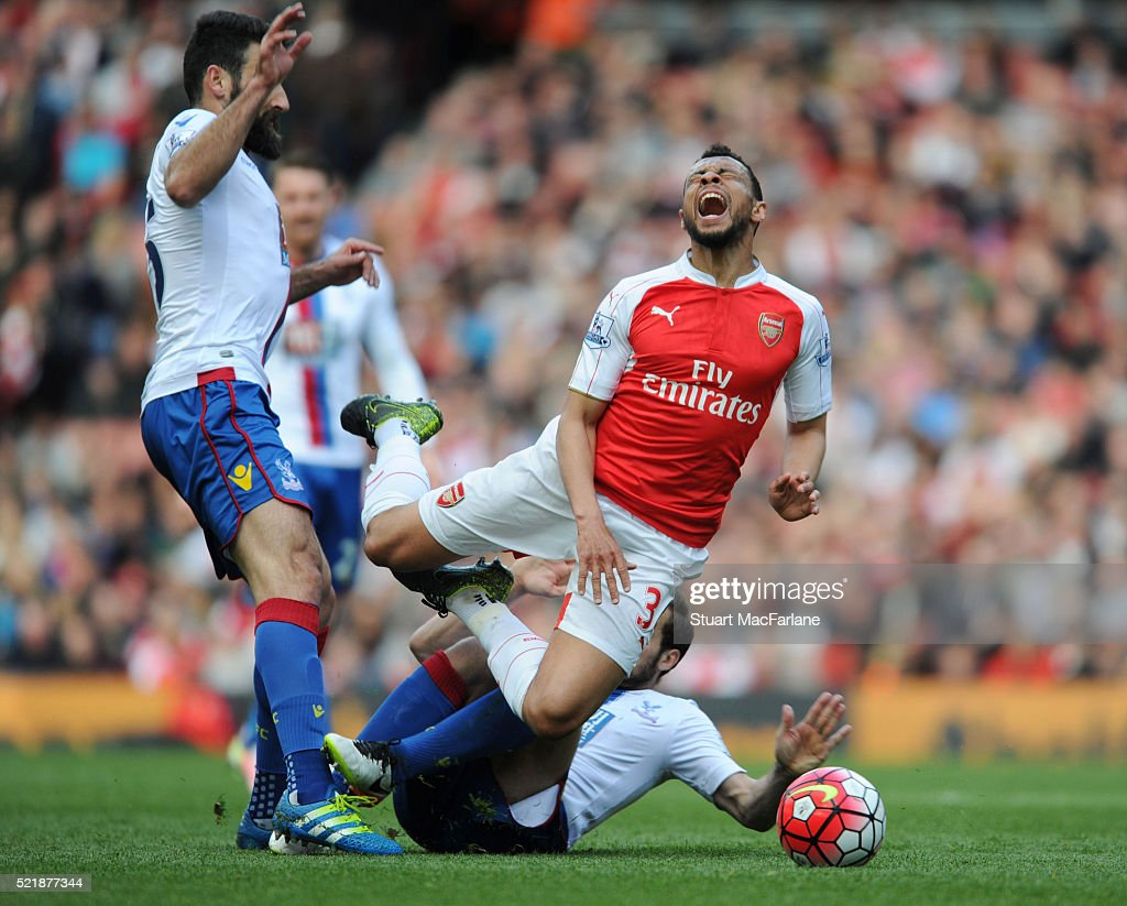 Francis Coquelin of Arsenal is challenged by (L) Mile Jedinak and (R) Yohan Cabaye of Crystal Palace during the Barclays Premier League match between Arsenal and Crystal Palace at Emirates Stadium on April 17, 2016 in London, England.