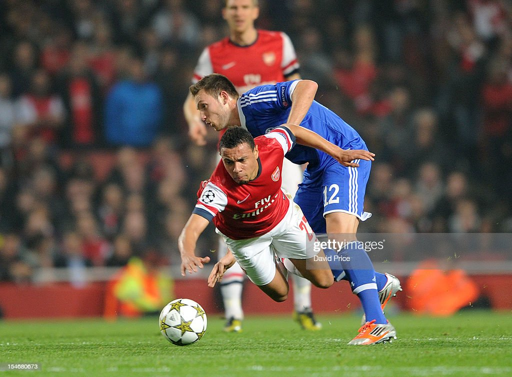 Francis Coquelin of Arsenal is fouled by Marco Hoger (R) of Schalke during the UEFA Champions League Group B match between Arsenal FC and FC Schalke 04 at Emirates Stadium on October 24, 2012 in London, England.