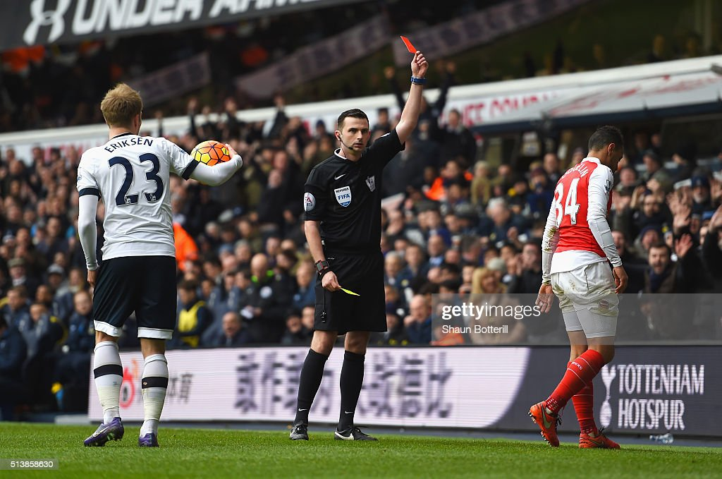 <a gi-track='captionPersonalityLinkClicked' href=/galleries/search?phrase=Francis+Coquelin&family=editorial&specificpeople=8957797 ng-click='$event.stopPropagation()'>Francis Coquelin</a> (R) of Arsenal is shown a red card by referee <a gi-track='captionPersonalityLinkClicked' href=/galleries/search?phrase=Michael+Oliver+-+Soccer+Referee&family=editorial&specificpeople=14095035 ng-click='$event.stopPropagation()'>Michael Oliver</a> (C) during the Barclays Premier League match between Tottenham Hotspur and Arsenal at White Hart Lane on March 5, 2016 in London, England.