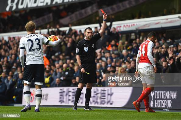 Francis Coquelin of Arsenal is shown a red card by referee Michael Oliver during the Barclays Premier League match between Tottenham Hotspur and...
