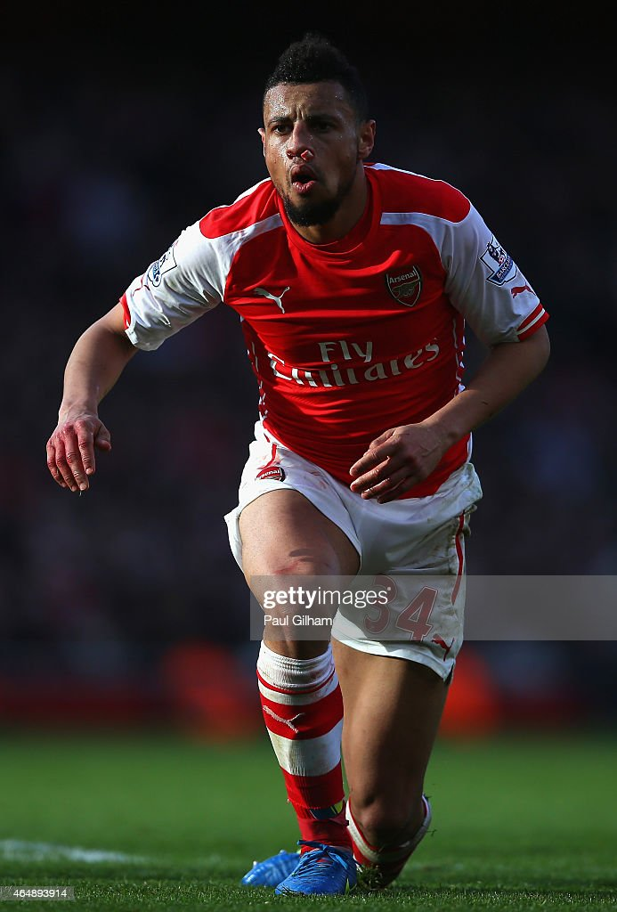 Francis Coquelin of Arsenal looks on after injuring his nose during the Barclays Premier League match between Arsenal and Everton at Emirates Stadium...