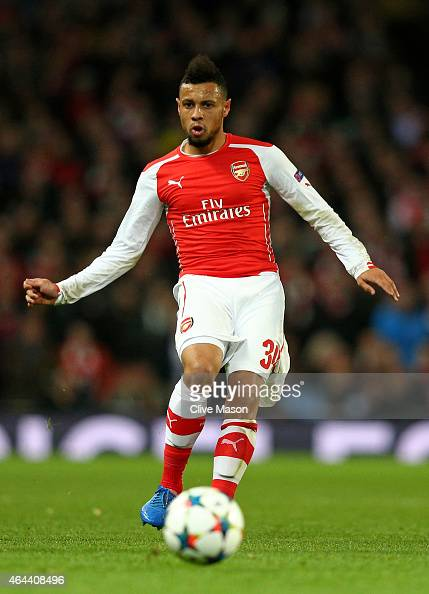 Francis Coquelin of Arsenal passes the ball during the UEFA Champions League round of 16 first leg match between Arsenal and Monaco at The Emirates...