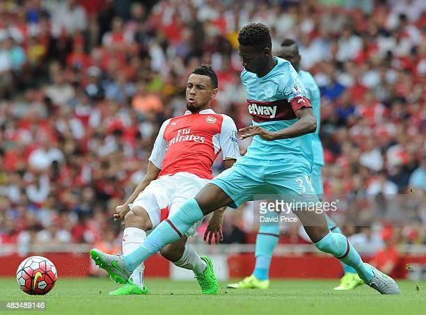 Francis Coquelin of Arsenal passes under pressure from Reece Oxford of West Ham during the Barclays Premier League match between Arsenal and West Ham...