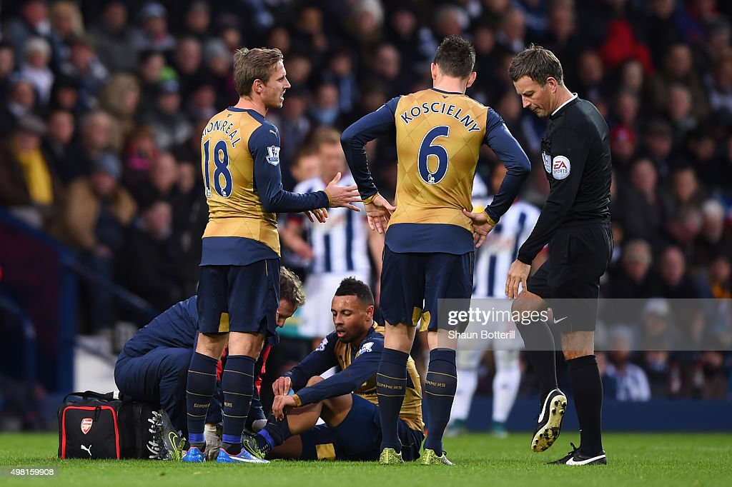 Francis Coquelin of Arsenal receives medical treatment during the Barclays Premier League match between West Bromwich Albion and Arsenal at The...