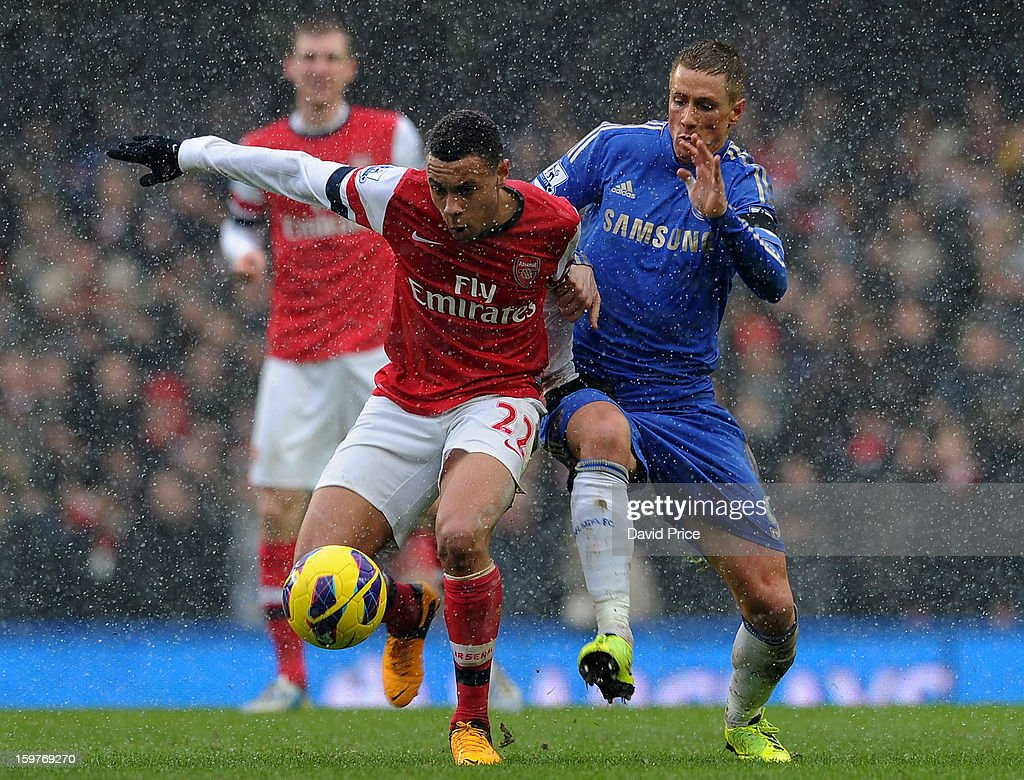 Francis Coquelin of Arsenal rides the challenge from Fernando Torres of Chelsea during the Barclays Premier League match between Chelsea and Arsenal at Stamford Bridge on January 20, 2013 in London, England.