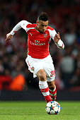 Francis Coquelin of Arsenal runs with the ball during the UEFA Champions League round of 16 first leg match between Arsenal and Monaco at The...