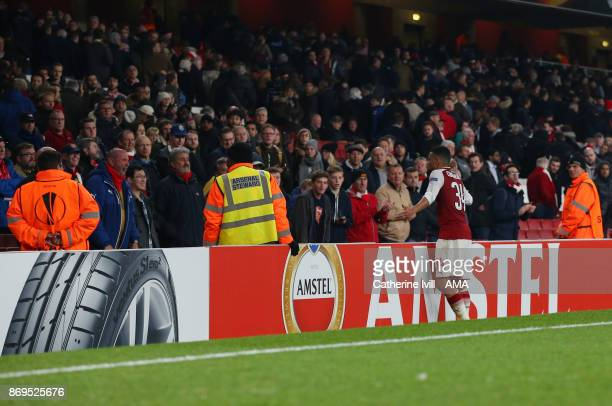 Francis Coquelin of Arsenal shrugs his shoulders as he goes over to the fans at the end of the UEFA Europa League group H match between Arsenal FC...