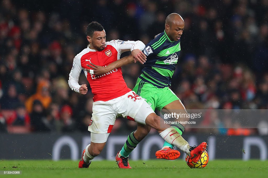 Francis Coquelin of Arsenal tackles Andre Ayew of Swansea City during the Barclays Premier League match between Arsenal and Swansea City at the...