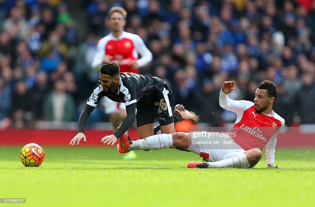 Francis Coquelin of Arsenal tackles Riyad Mahrez of Leicester City during the Barclays Premier League match between Arsenal and Leicester City at the Emirates Stadium on February 14, 2016 in London, England.