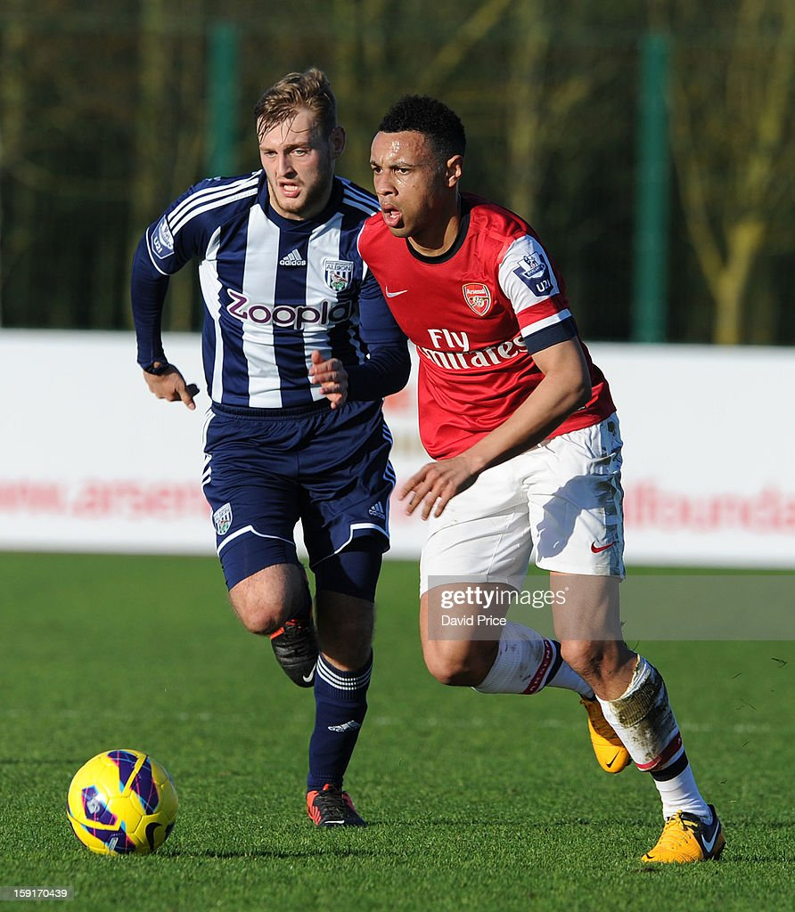 Francis Coquelin of Arsenal takes on Aaron Birch of WBA during the Barclays Premier U21 match between Arsenal U21 and West Bromwich Albion U21 at London Colney on January 9, 2013 in St Albans, United Kingdom.