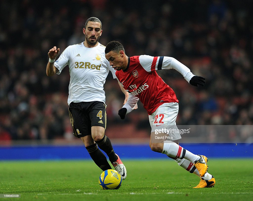 <a gi-track='captionPersonalityLinkClicked' href=/galleries/search?phrase=Francis+Coquelin&family=editorial&specificpeople=8957797 ng-click='$event.stopPropagation()'>Francis Coquelin</a> of Arsenal takes on Chico Flores of Swansea during the FA Cup Third Round Replay match between Arsenal and Swansea City at the Emirates Stadium on January 16, 2013 in London, England.