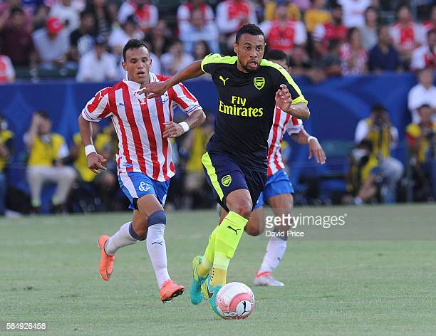 Francis Coquelin of Arsenal takes on Daniel Gonzalez of Guadalajara during the match between Arsenal and CD Guadalajara at StubHub Center on July 31...