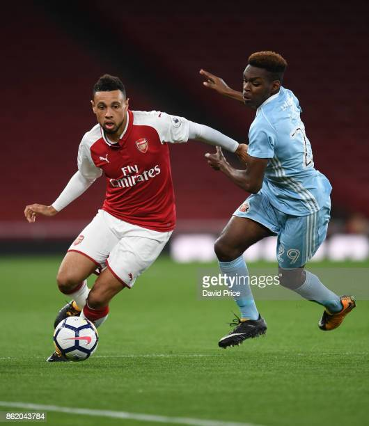 Francis Coquelin of Arsenal takes on Joel Asoro of Sunderland during the Premier League 2 match between Arsenal and Sunderland at Emirates Stadium on...