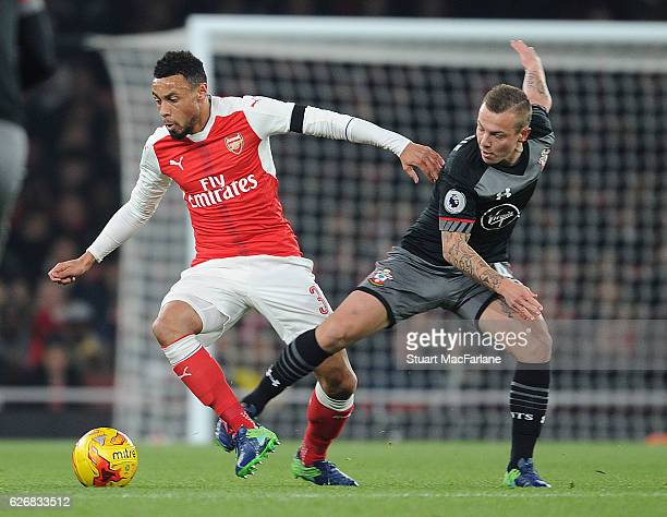 Francis Coquelin of Arsenal takes on Jordy Clasie of Southampton during the EFL Quarter Final Cup match between Arsenal and Southampton at Emirates...
