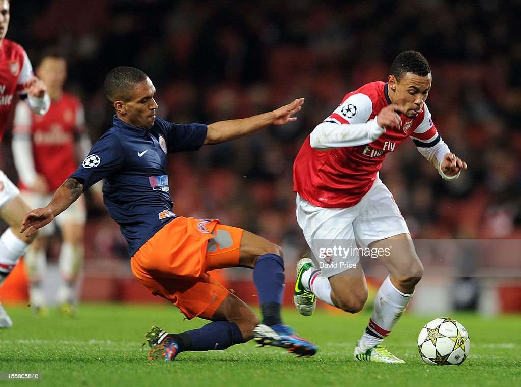 Francis Coquelin of Arsenal takes on Joris Marveaux of Montpellier during the UEFA Champions League Group B match between Arsenal FC and Montpellier Herault SC at Emirates Stadium on November 21, 2012 in London, England.