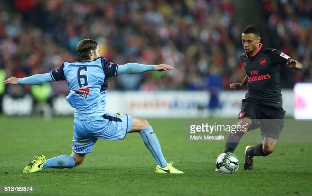 Francis Coquelin of Arsenal takes on Joshua Brilliante of Sydney FC during the match between Sydney FC and Arsenal FC at ANZ Stadium on July 13 2017...