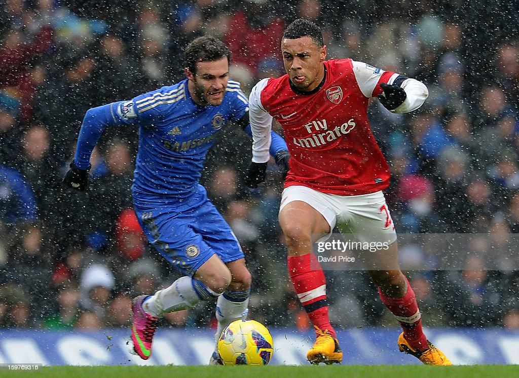 Francis Coquelin of Arsenal takes on Juan Mata of Chelsea during the Barclays Premier League match between Chelsea and Arsenal at Stamford Bridge on January 20, 2013 in London, England.