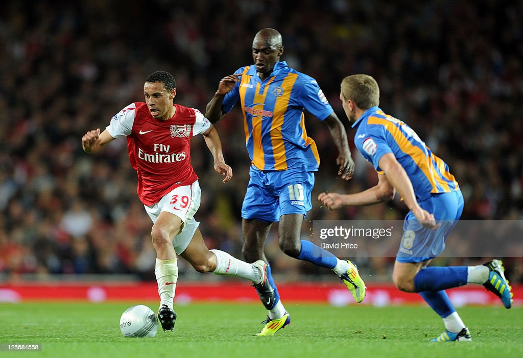 Francis Coquelin of Arsenal takes on Marvin Morgan and Nicky Wroe of Shrewsbury during the Carling Cup Third Round match between Arsenal and Shrewsbury Town at Emirates Stadium on September 20, 2011 in London, England.